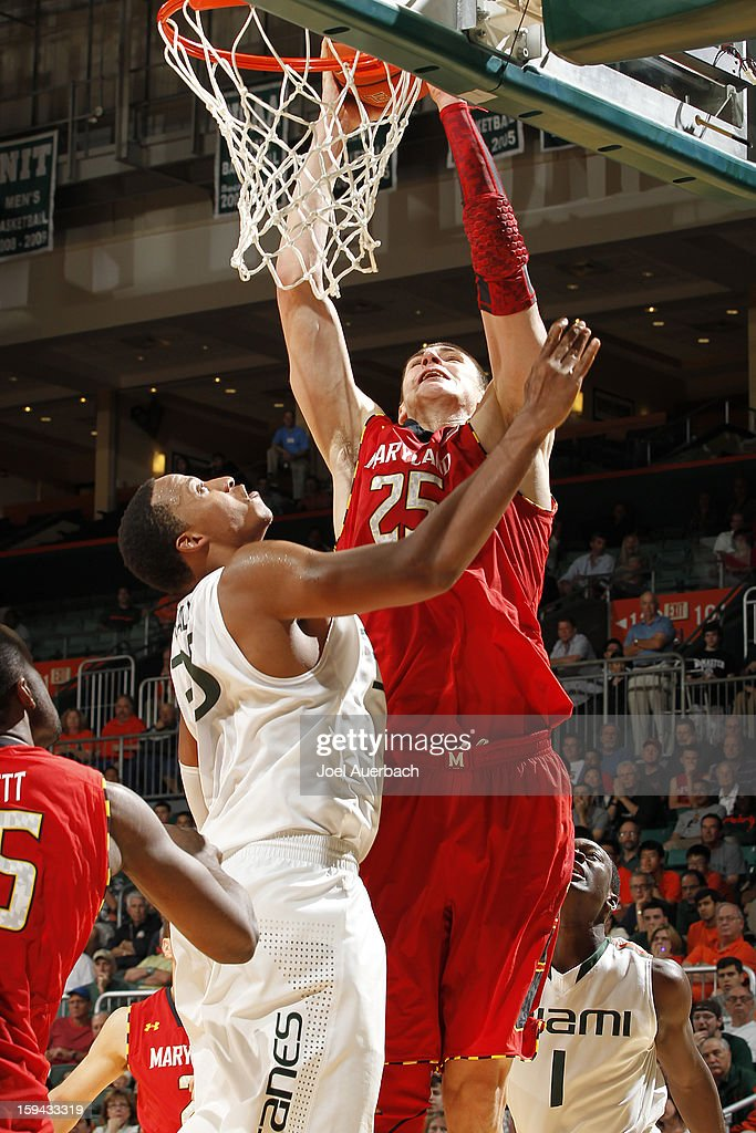 Alex Len #25 of the Maryland Terrapins scores over Kenny Kadji #35 of the Miami Hurricanes on January 13, 2013 at the BankUnited Center in Coral Gables, Florida. Miami defeated Maryland 54-47.