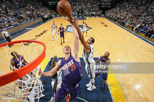 Alex Len of the Phoenix Suns and Brandan Wright of the Memphis Grizzlies go up for a rebound on February 8 2017 at FedExForum in Memphis Tennessee...