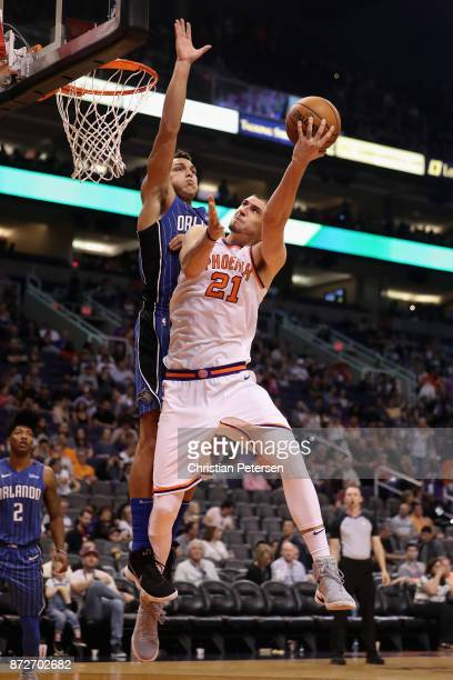 Alex Len of the Phoenix Suns attempts a shot against Aaron Gordon of the Orlando Magic during the second half of the NBA game at Talking Stick Resort...