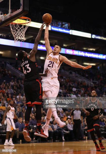 Alex Len of the Phoenix Suns attempts a slam dunk over Pascal Siakam of the Toronto Raptors during the second half of the NBA game at Talking Stick...
