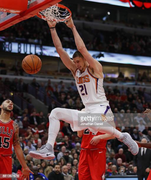 Alex Len of the Phoenix Suns dunks against the Chicago Bulls at the United Center on November 28 2017 in Chicago Illinois The Suns defeated the Bulls...
