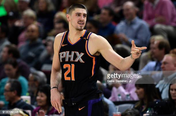 Alex Len of the Phoenix Suns gestures towards the bench during the second half of a game against the Utah Jazz at Vivint Smart Home Arena on February...