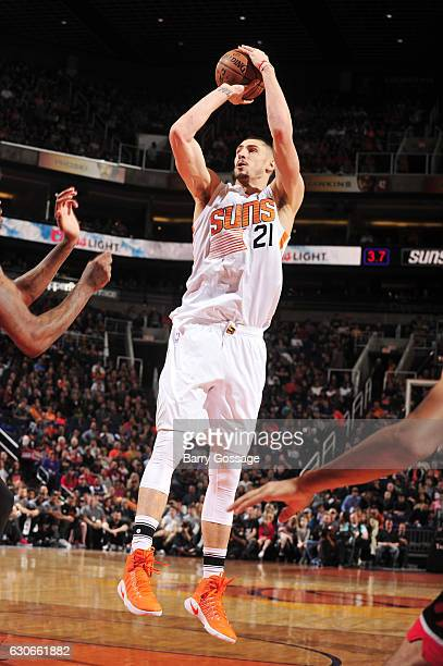 Alex Len of the Phoenix Suns goes up for a shot during a game against the Toronto Raptors on December 29 2016 at Talking Stick Resort Arena in...