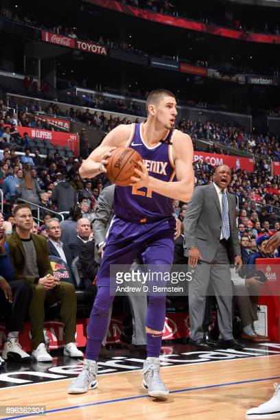 Alex Len of the Phoenix Suns handles the ball against the LA Clippers on December 20 2017 at STAPLES Center in Los Angeles California NOTE TO USER...