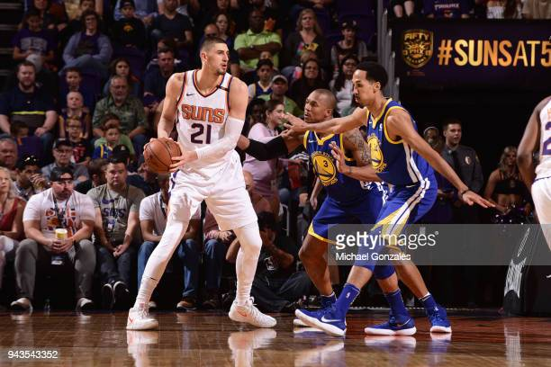 Alex Len of the Phoenix Suns handles the ball against the Golden State Warriors on April 8 2018 at Talking Stick Resort Arena in Phoenix Arizona NOTE...