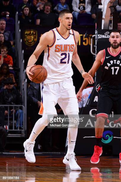 Alex Len of the Phoenix Suns handles the ball against the Toronto Raptors on December 13 2017 at Talking Stick Resort Arena in Phoenix Arizona NOTE...