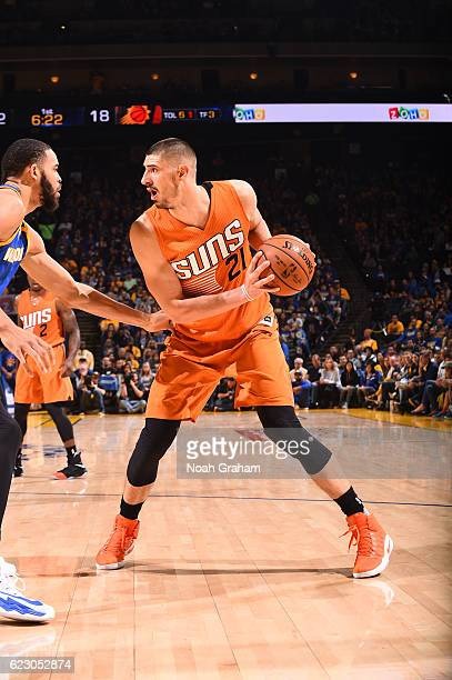 Alex Len of the Phoenix Suns handles the ball during a game against the Golden State Warriors on November 13 2016 at ORACLE Arena in Oakland...