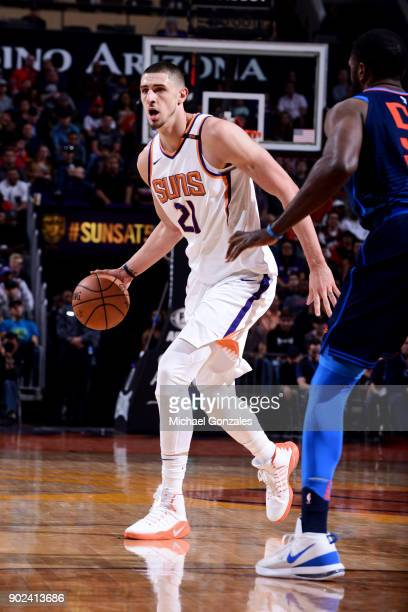 Alex Len of the Phoenix Suns handles the ball during the game against the Oklahoma City Thunder on January 7 2018 at Talking Stick Resort Arena in...