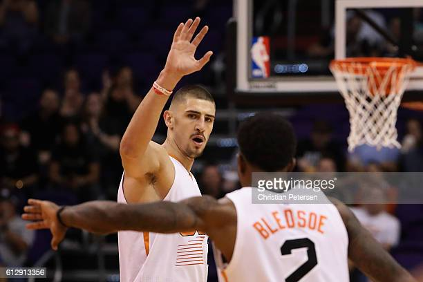 Alex Len of the Phoenix Suns high fives Eric Bledsoe after scoring against the Utah Jazz during the second half of the preseason NBA game at Talking...