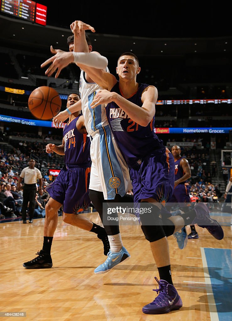 Alex Len #21 of the Phoenix Suns is fouled by Jusuf Nurkic #23 of the Denver Nuggets as they pursue a loose ball at Pepsi Center on February 25, 2015 in Denver, Colorado. The Suns defeated the Nuggets 110-96.