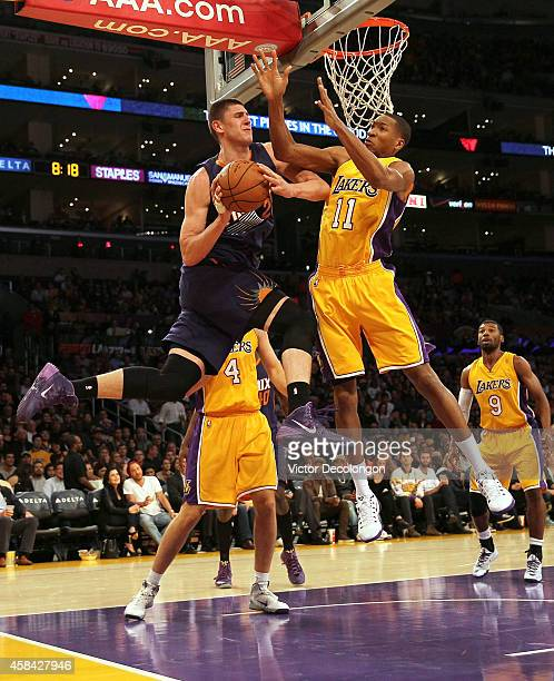 Alex Len of the Phoenix Suns looks to make a pass play against Wesley Johnson of the Los Angeles Lakers in the second period during the NBA game at...