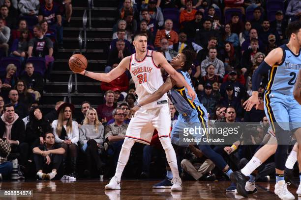 Alex Len of the Phoenix Suns passes the ball against the Memphis Grizzlies on December 26 2017 at Talking Stick Resort Arena in Phoenix Arizona NOTE...
