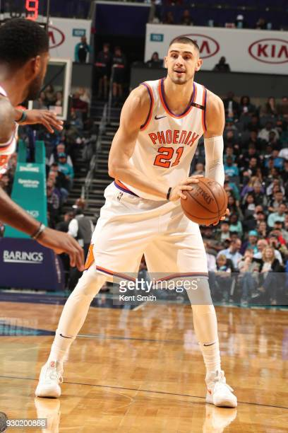 Alex Len of the Phoenix Suns passes the ball during the game against the Charlotte Hornets on March 10 2018 at Spectrum Center in Charlotte North...