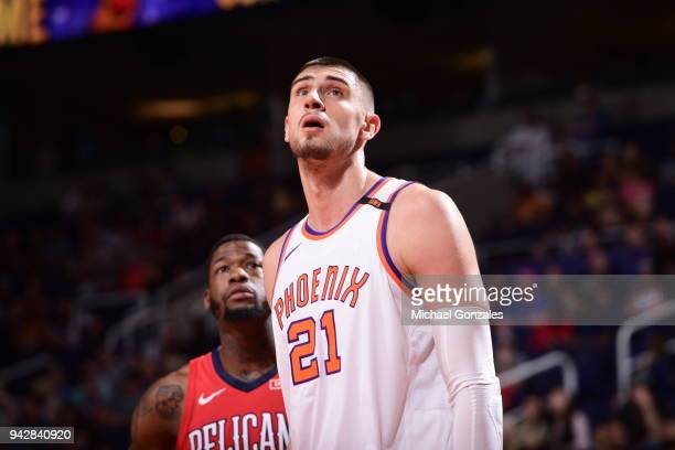 Alex Len of the Phoenix Suns plays defense against DeAndre Liggins of the New Orleans Pelicans on April 6 2018 at Talking Stick Resort Arena in...