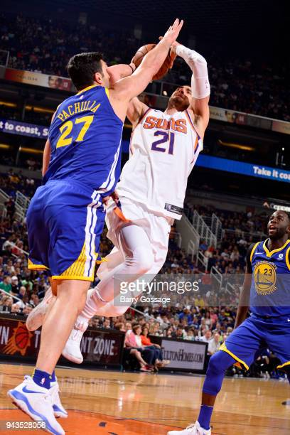 Alex Len of the Phoenix Suns shoots the ball during the game against Zaza Pachulia of the Golden State Warriors on April 8 2018 at Talking Stick...