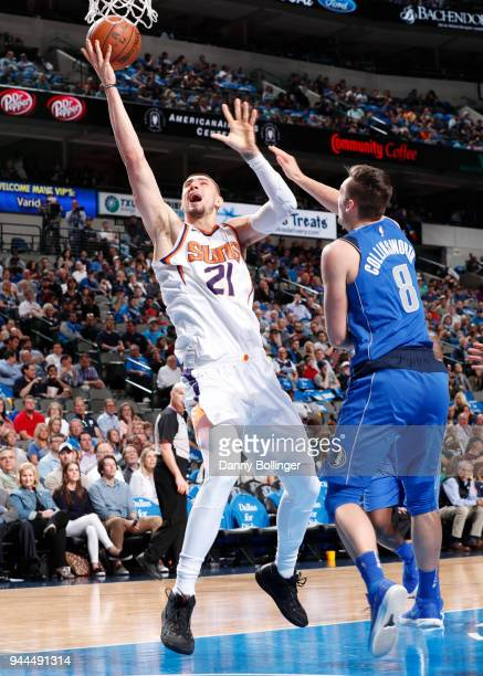 Alex Len of the Phoenix Suns shoots the ball during the game against the Dallas Mavericks on April 10 2018 at the American Airlines Center in Dallas...