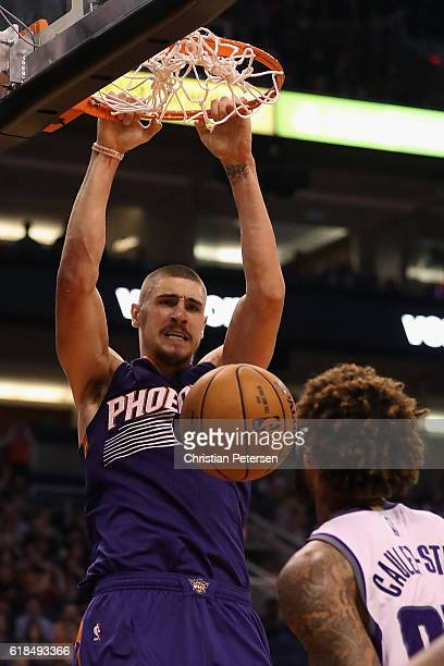 Alex Len of the Phoenix Suns slam dunks the ball against the Sacramento Kings during the second half of the NBA game at Talking Stick Resort Arena on...