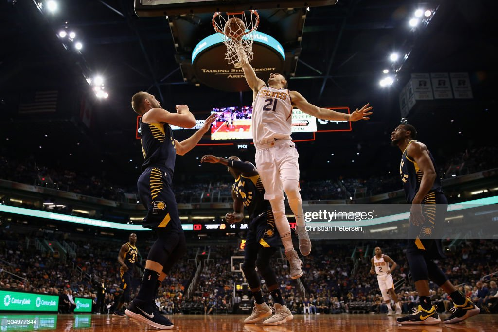 Alex Len #21 of the Phoenix Suns slam dunks the ball over Victor Oladipo #4 of the Indiana Pacers during the first half of the NBA game at Talking Stick Resort Arena on January 14, 2017 in Phoenix, Arizona.