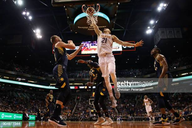 Alex Len of the Phoenix Suns slam dunks the ball over Victor Oladipo of the Indiana Pacers during the first half of the NBA game at Talking Stick...