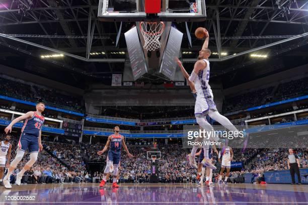 Alex Len of the Sacramento Kings dunks the ball against the Washington Wizards on March 3 2020 at Golden 1 Center in Sacramento California NOTE TO...
