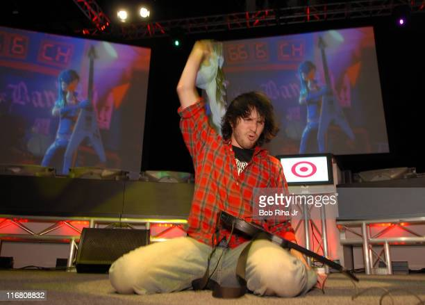 Alex Lerner 19 from River Dale New Jersey concludes his winning performance during the Guitar Hero II video game contest presented by Target at the E...