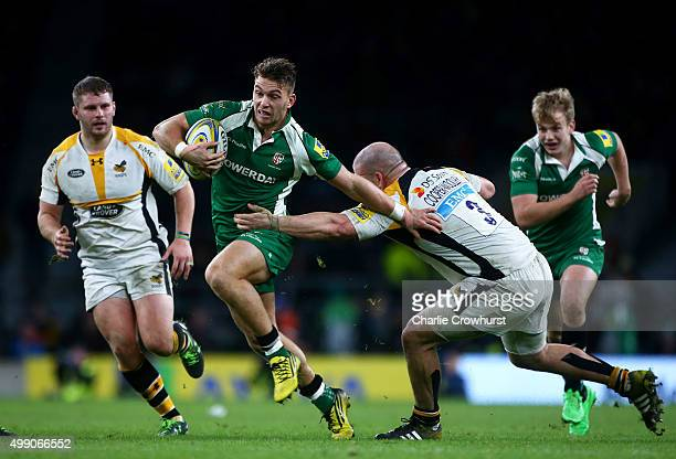 Alex Lewington of London Irish breaks through the Wasps defence during the Aviva Premiership match between London Irish and Wasps at Twickenham...
