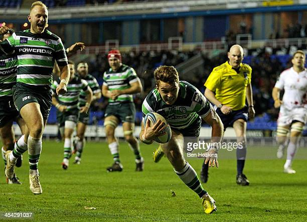 Alex Lewington of London Irish dives over to score a try during the Amlin Challenge Cup match between London Irish and Stade Francais Paris at...