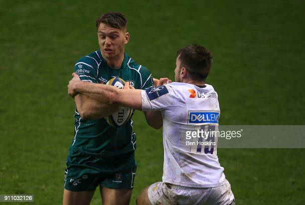 Alex Lewington of London Irish is tackled by Nick Foster in Wasps during the AngloWelsh Cup match between London Irish and Wasps at Madejski Stadium...
