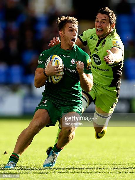 Alex Lewington of London Irish is tackled by Phil Dowson of Northampton during the Aviva Premiership match between London Irish and Northampton...