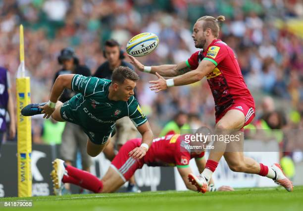Alex Lewington of London Irish releases the ball as Charlie Walker of Harlequins moves in during the Aviva Premiership match between London Irish and...