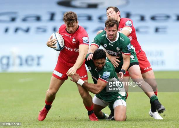 Alex Lewington of Saracens getting tackled by Curtis Rona of London Irish during the Gallagher Premiership match between London Irish and Saracens at...