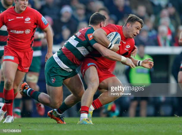 Alex Lewington of Saracens is tackled by Adam Thompstone of Leicester Tigers during the Gallagher Premiership Rugby match between Leicester Tigers...