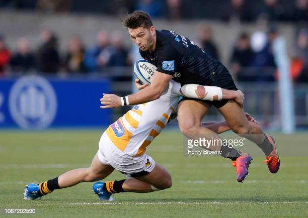 Alex Lewington of Saracens is tackled by Michael Le Bourgeois of Wasps during the Gallagher Premiership Rugby match between Saracens and Wasps at...