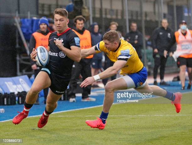 Alex Lewington of Saracens is tackled by Ruaridh McConnochie of Bath Rugbyduring the Gallagher Premiership Rugby match between Saracens and Bath...