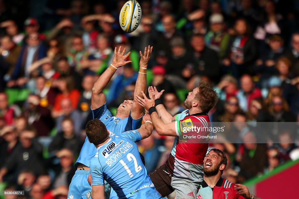 Alex Lexington and Theo Trophy Clews of London Irish challenge for the ball in the air with Charlie Walker of Harlequins during the Aviva Premiership match between Harlequins and London Irish at Twickenham Stoop on April 7, 2018 in London, England.
