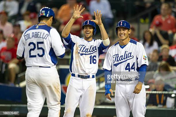 Alex Liddi and Anthony Rizzo of Italy celebrate a home run hit by Chris Colabello of Italy against Canada during the World Baseball Classic First...