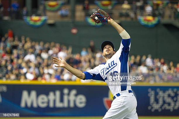 Alex Liddi of Italy catches a fly ball against Team USA during the World Baseball Classic First Round Group D game on March 9 2013 at Chase Field in...