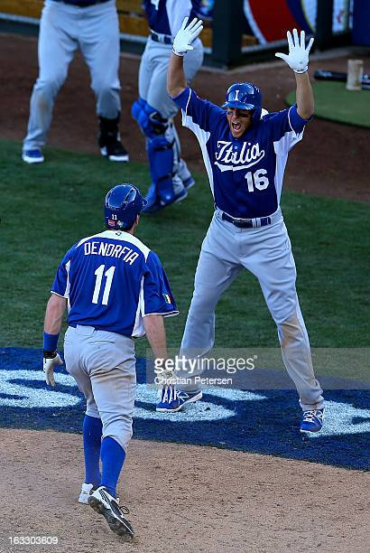 Alex Liddi of Italy celebrates with Chris Denorfia after Denorfia scored the go ahead run against Mexico during the ninth inning of the World...