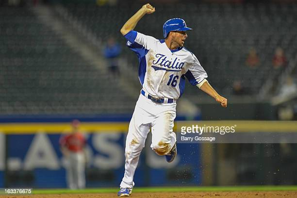 Alex Liddi of Team Italy celebrates as he rounds the bases to score on Chris Colabello's threerun home run in the bottom of the third inning of Pool...