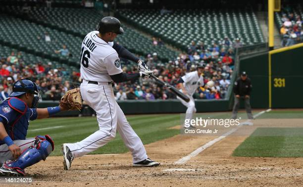 Alex Liddi of the Seattle Mariners hits a grand slam against the Texas Rangers at Safeco Field on May 23 2012 in Seattle Washington