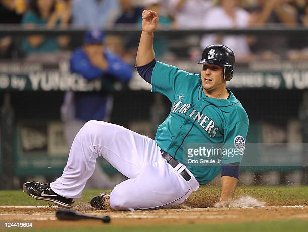 Alex Liddi of the Seattle Mariners scores on a single against the Kansas City Royals at Safeco Field on September 9 2011 in Seattle Washington