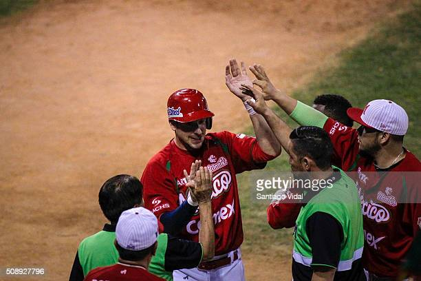 Alex Liddi of Venados de Mazatl‡an celebrates with his teammates after winning a semifinal match between Ciego de Avila from Cuba and Venados de...