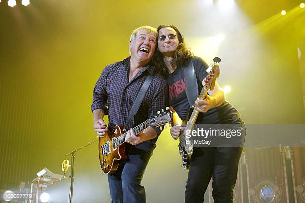 Alex Lifeson and Geddy Lee perform with Rush on the 'Time Machine Tour' at the Susquehanna Bank Center on July 21 2010 in Camden New Jersey