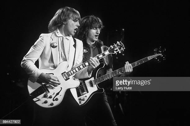 Alex Lifeson and Geddy Lee perform with their band 'Rush' during the Moving Pictures tour They are performing at the OaklandAlameda County Coliseum...