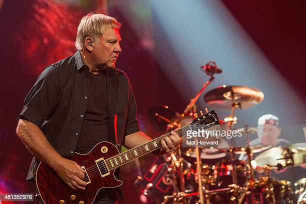 Alex Lifeson and Neil Peart of Rush perform on stage during the R40 LIVE Tour at KeyArena on July 19 2015 in Seattle Washington