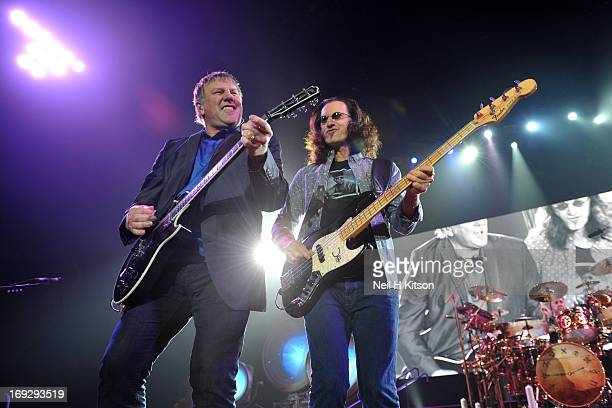 Alex Lifeson Geddy Lee and Neil Peart of Rush perform on stage at Manchester Arena on May 22 2013 in Manchester England