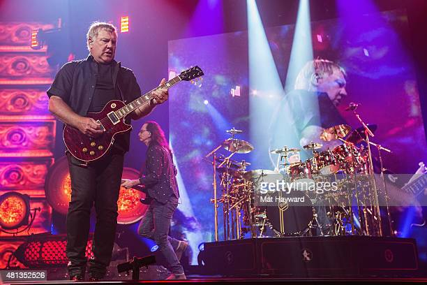 Alex Lifeson Geddy Lee and Neil Peart of Rush perform on stage during the R40 LIVE Tour at KeyArena on July 19 2015 in Seattle Washington