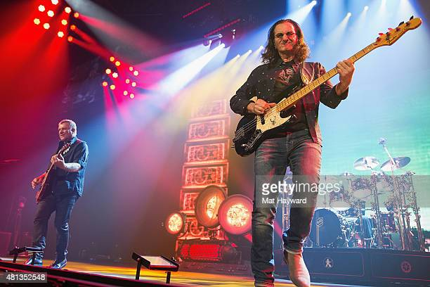 Alex Lifeson Geddy Lee and Neil Peart of Rush performs on stage during the R40 LIVE Tour at KeyArena on July 19 2015 in Seattle Washington