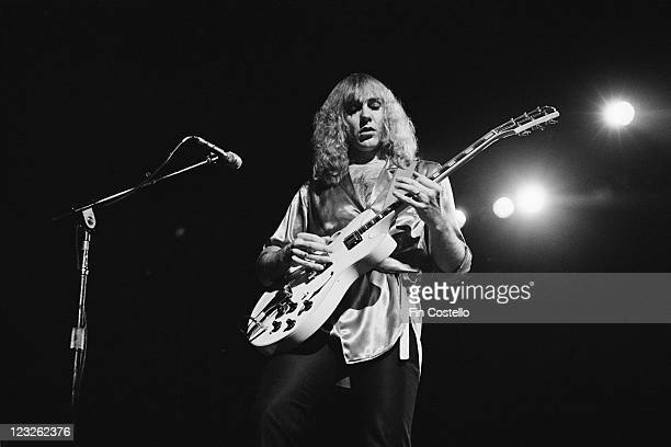 Alex Lifeson guitarist with Canadian rock band Rush playing the guitar during a live concert performance by the band at the Gaumont in Southampton...