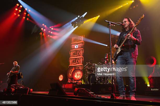 Alex Lifeson Neil Peart and Geddy Lee of Rush perform on stage during the R40 LIVE Tour at KeyArena on July 19 2015 in Seattle Washington
